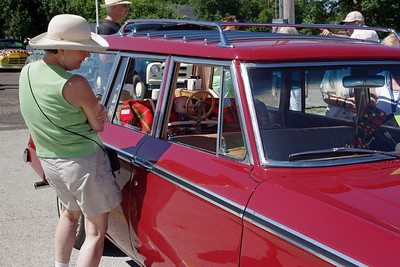 Rita checking out a 1964 Studebaker Wagonaire. 47th Annual Studebaker Drivers Club Meet, Springfield, MO. June 23, 2011.