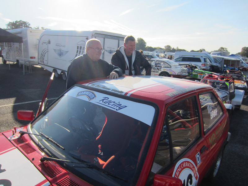 The sun is shining as Neil and Dave wait in the scruitineering queue.