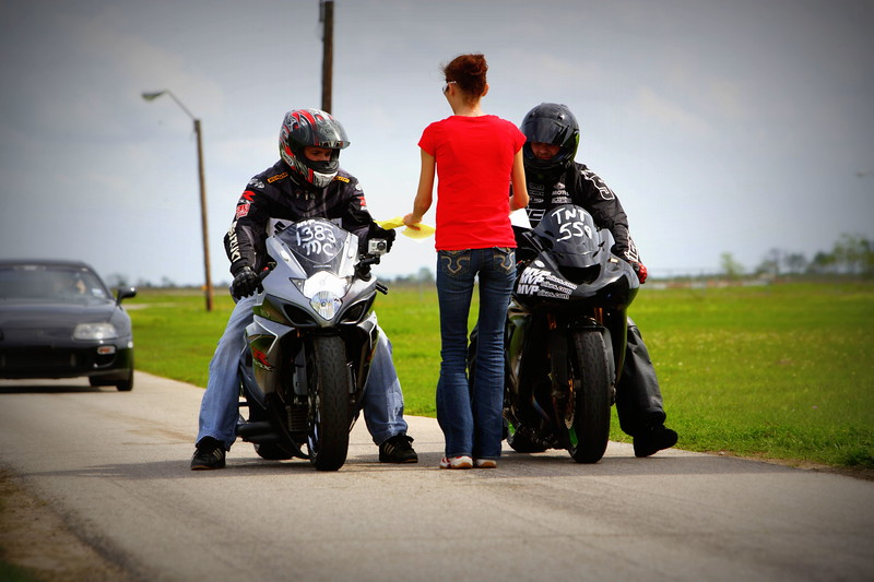 Two Race Motorcycles Receiving Time Slips  @ TX2K12 at Lonestar Raceway. Photos Taken By: Andre Leighton / ASLPHOTOGRAPHY.net Photography Service Available In Many Cities: Dallas, Houston, San Antonio, Austin & From East to West Coast