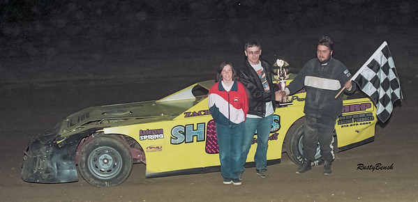 Jack Shore won the street stocks. Pictured is Bill Fairchild and his daughter making the presentations.