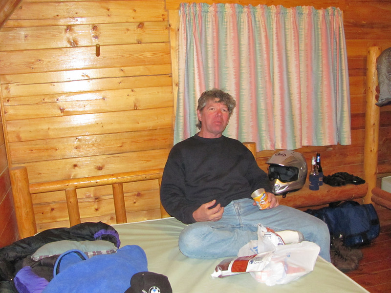 Kieth in cabin after the tents took water during a hail storm....drying out the gear....