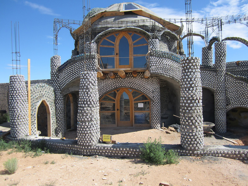 EarthShip house in progress..beer cans and concrete. outside Taos New Mexico.