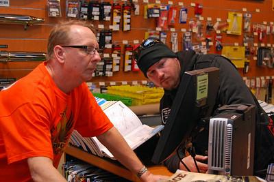 007 Bruce from  J&P Cycles helping a Bike Week Customer