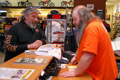 025 Kenny from J&P Cycles helping a Bike Week Customer