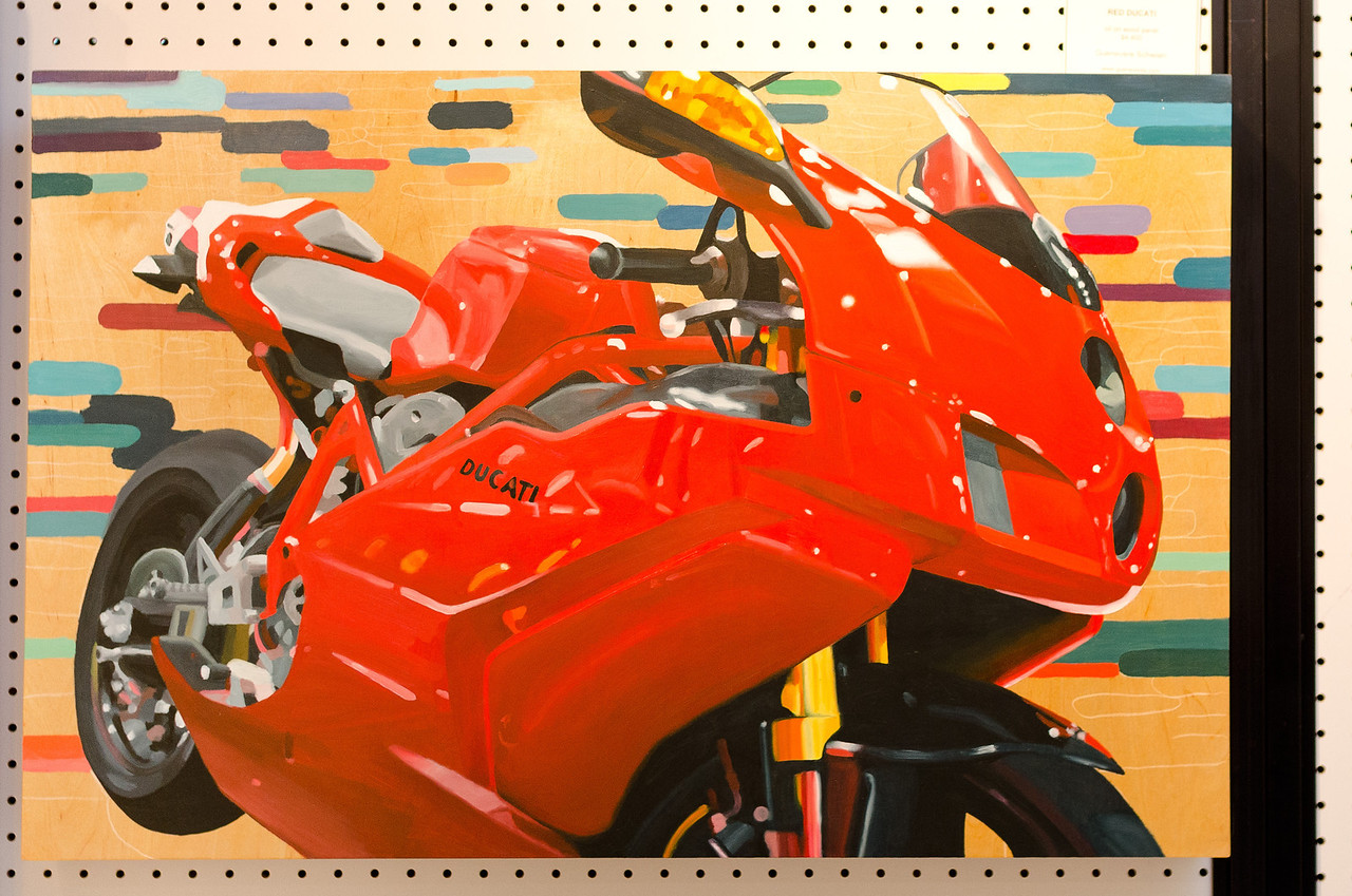 "<div style=""text-align:left !important""> <h2>""Red Ducati"" by Guenevere Schwien</h2> <br> </div>"