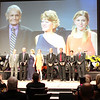 """The AMA Motorcycle Hall of Fame Class of 2012. L-R: Roger Lyle, representing the late Al Wilcox; Derek """"Nobby"""" Clark; Cheri Bush and Stacy Bush, representing the late Rod Bush; Jimmy Ellis; Ty Davis; Sue Fish; and Brian Slark. Photo credit: Jeff Guciardo/American Motorcyclist Association"""