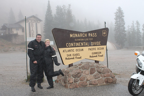Rain and Fog and Cold on Monarch pass - The pass is located on the continental divide at the southern end of the Sawatch Range along the border between Gunnison and Chaffee counties, approximately 25 miles (40 km) west of the town of Salida. The pass carries U.S. Highway 50 over the Sawatch Range, providing a route between Tomichi Creek in the upper basin of the Gunnison River on the west and the South Arkansas River, a tributary of the Arkansas River on the east. The pass is traversable by all vehicles under most conditions and is generally open year-round; however, 7% grades exist. It is prone to heavy winter snowfall however, and is often temporarily closed in heavy winter storms. Ramps for runaway trucks are located about halfway down both the eastern and western sides of the pass.