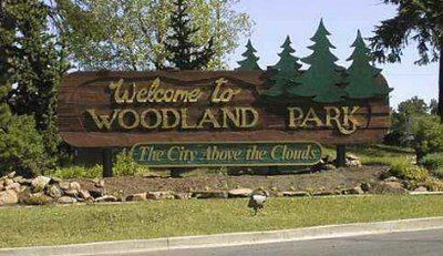 """The City of Woodland Park is a Home Rule Municipality that is the most populous city in Teller County, Colorado, United States and is immediately west of El Paso County and the unincorporated community of Crystola. Many residents in this bedroom community, which is surrounded by the one-million acre (4,000 km²) Pike National Forest, make the 17-mile (27 km) commute to Colorado Springs. Ute Pass lies 12 miles (19 km) to the west of Woodland Park on US 24. The population was 6,515 at the 2000 census. Nearby Douglas County is about a fifteen-minute drive from the city.<br />  <br /> Woodland park - Called the """"The City Above the Clouds,"""" Woodland Park, at 8,465 feet (2,580 m) above sea level, often enjoys clear skies while weather in neighboring towns may be rainy or overcast. The city has pursued a policy of careful growth, and enjoys breathtaking views of Pikes Peak. Woodland Park offers easy access to hiking, climbing, and fishing. Because of the city's location, there is a natural limitation to population growth.<br /> <br /> PS , I did not take this picture as it was pouring rain coming into Woodland Park"""
