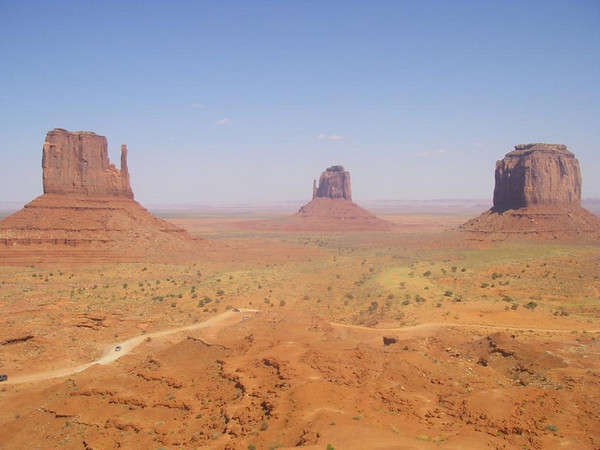 Monument Valley - Arizona.  The famous view of the two Mittins.<br /> You can just image John Wayne riding his horse around the next bend.