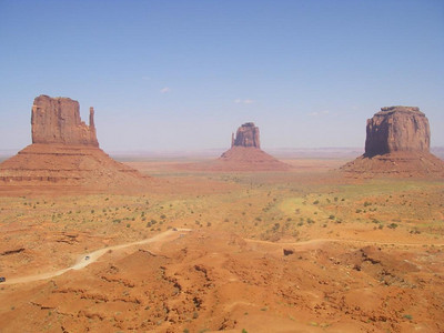 Monument Valley - Arizona.  The famous view of the two Mittins. You can just image John Wayne riding his horse around the next bend.