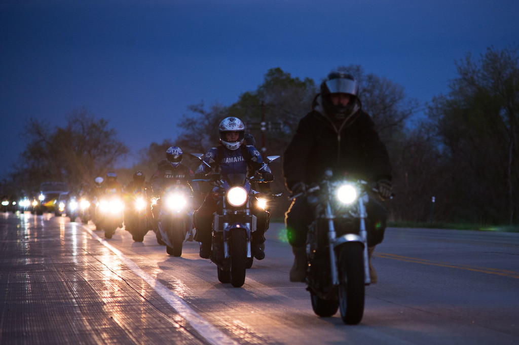 . N0419CYCLE5 Nearly a hundred fellow motorcyclists ride to the ceremony on Monday evening April 18th, 2017, to erect a memorial for Grayson Wolff at the site where Wolff died in a motorcycle crash on highway 66 near Lyons on Sunday.  Photo by: Jonathan Castner