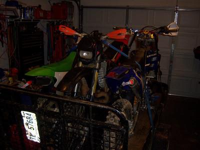 3 Dirt bikes on trailer