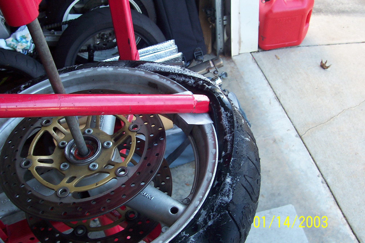 Get the tool all the way in and then pull the bead up over the rim.<br /> <br /> If you deform your tire while breaking the bead, you make this step much harder.