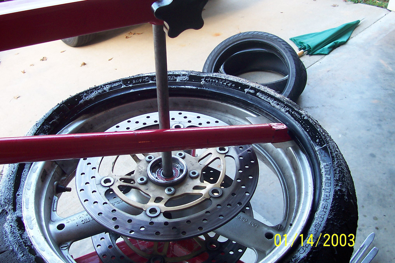 Keep working it around and be certain to keep your rim protector under your tool.  Once you get started this part will be very easy.