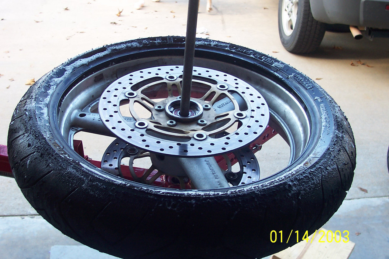 Once you get about 1/2 the bead off, the top part of the tire will come up with ease.