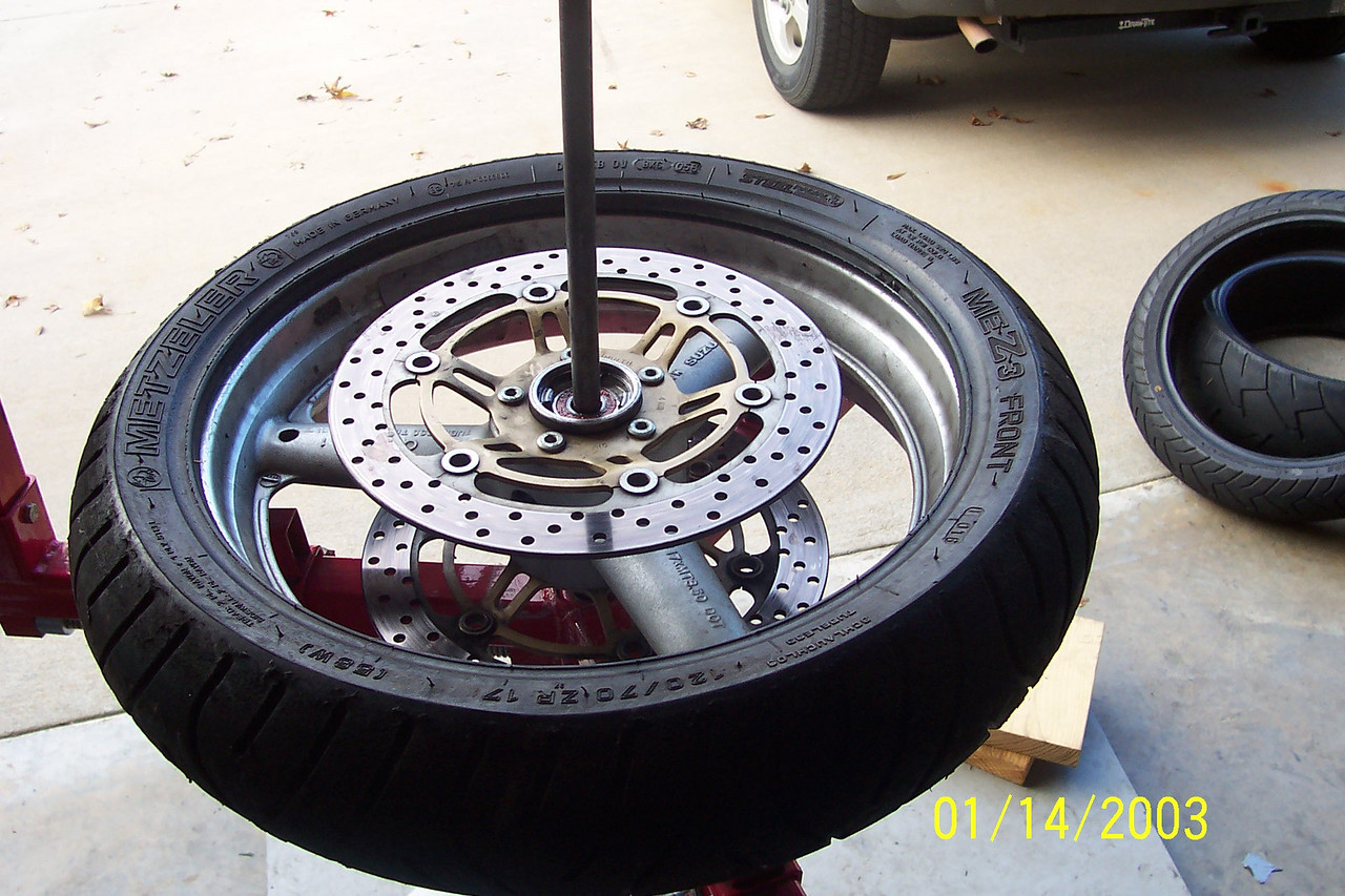Now you have the lower bead mounted.<br /> <br /> It's always a good idea to double check your tire rotation once more and also make sure you keep that paint spot lined up with the valve stem.
