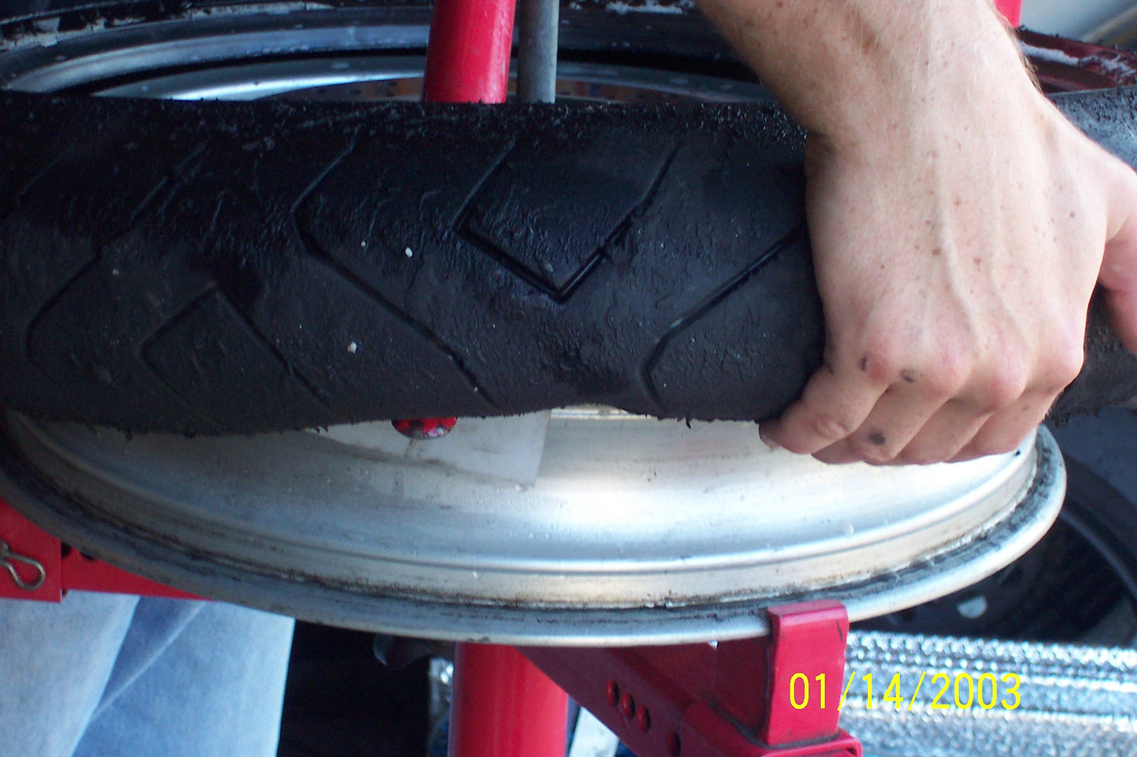 Work your way around pulling up on the tire.