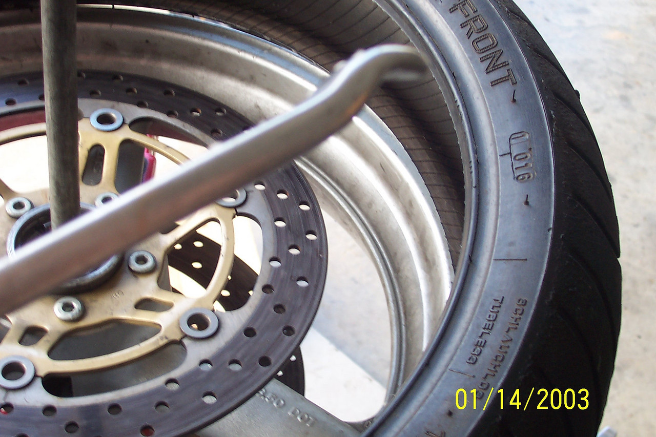 If you can't get the lower bead all the way on, use one of your smaller tire irons to get it over the reaminder of the rim.  Use the end with the curve that fits or the the lip of the rim.