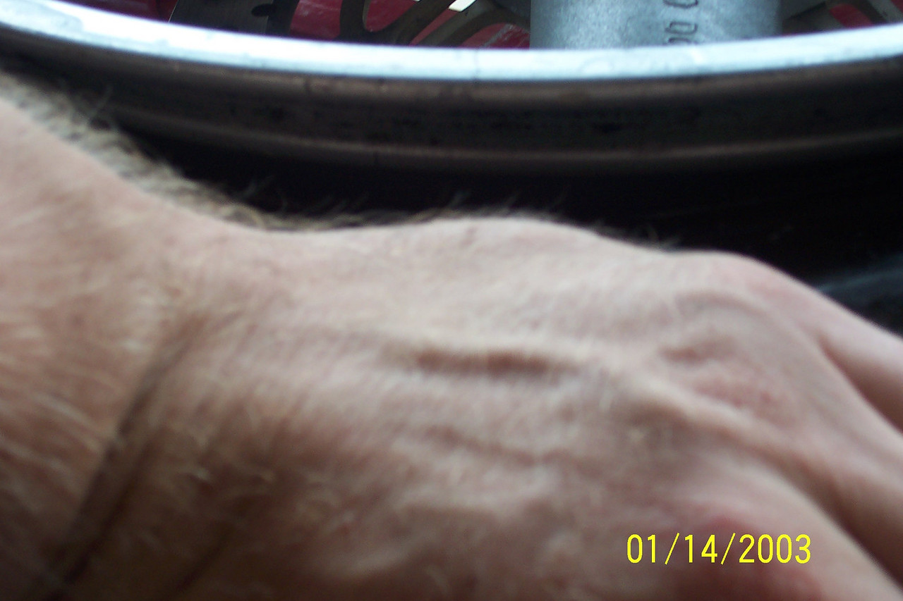 This is a very important part that most people mess up on! As you work the tool around seating the bead, you need to keep the part of the tire you have already mounted below the lip on the inside of the rim. This gives you more room to work with as the rim is more narrow here.<br /> <br /> Again, this is where 2 sets of hands comes in handy.  Have your assistant constantly pushing the tire down in different spots to keep it below that lip.