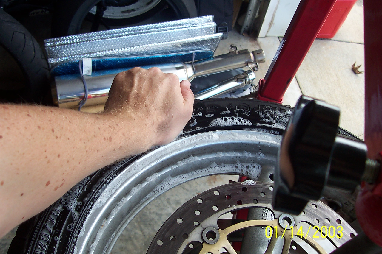 Push down the tire in the 8:00 position.