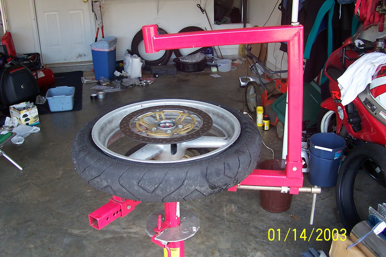 Next get the largest rod that will fit through your axle hole.
