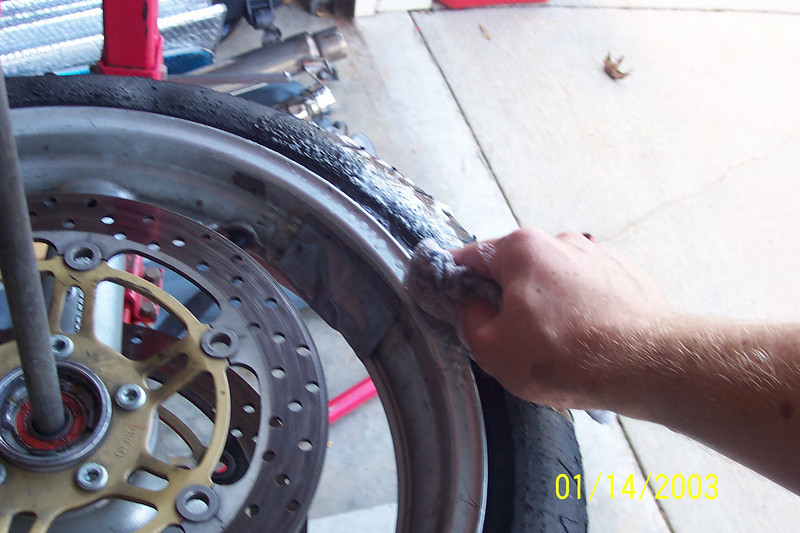 Using very generous amounts of soapy water and wet down the tire bead and the rim.