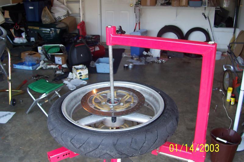 Install the rod through the axle hole.