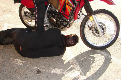 9/24/06 - Robert goes to great lengths to get the shot right, or,... he's awfully interested in the KLR's drain plug.