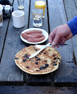 9/24/06 - A blueberry pancake, overflowing its container.