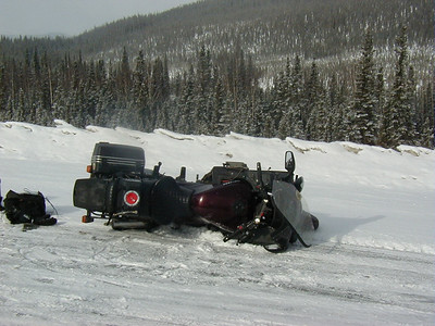 "4/7/02 - Around Mile 1150 of the Alaska Highway, just above Dry Creek #2. This wasn't technically a ""winter"" ride, as spring was two weeks old at the time, but it got me to thinking that a winter ride was possible, ""if"" I could get some tires that would work in the snow - better than these!"