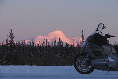 2/11/07 5:12 PM - Alpenglow from the sun setting on Mt Sanford helps to furnish the beauty that year-round Alaskans find irresistible.