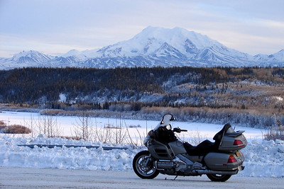 February 3, 2007:  At the Gakona Overlook above the frozen Copper River, with Mt Sanford in the distant background.