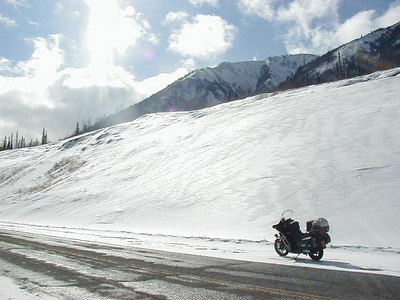 4/7/02 - Mile 1136 of the Alaska Highway.  Back up on two wheels, I enjoyed the bare pavement where the sun had been melting the snow.