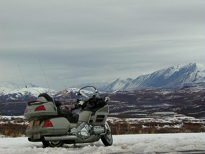 9/28/03 - On the Denali Hwy., overlooking Isabel Pass in the Alaska Range.  The new Wing gets its baptism in snow. Still not a real winter ride though.  Photo won MTF Photo of the Month in September 2003.