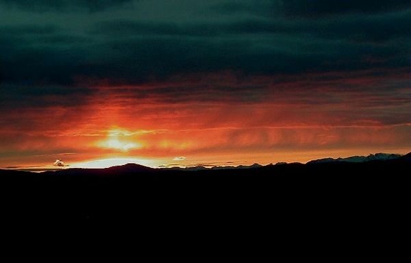 A fall sunset over the Alaska Range as seen from about MP16 on the Denali Hwy.