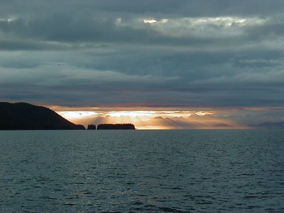 A sunrise over Valdez from out in Prince William Sound near Naked Island.