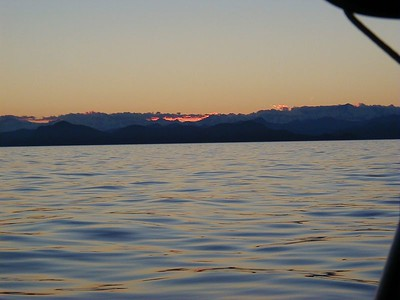 Sun setting over the mountains of the Kenai Peninsula on the western edge of Prince William Sound.