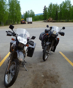 May 28, 2011  9:00 AM:  Our two bikes (mine the beautiful KLR on the right, the other a DR650 that does all right on gravel roads despite its looks), ready to head north and find the Haul Road.