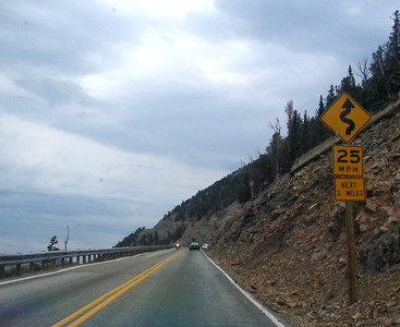 Monday, July 24: About 1/4 of the way up to the top of Beartooth Pass, with a clean windshield this time, and the polarizing filter safely stowed in the accessories bag, this sign brings joy to the motorcyclist's heart.