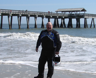 Thursday - 3/9:  My riding partner for the 50CC, Steve Broadhead of Calgary, Alberta, shares my joy at completing the ride by getting his own boots soaked by the surf in the Atlantic.