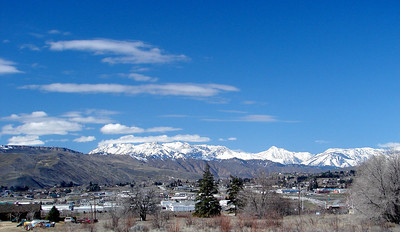 Sunday - 3/19:  Seen across the Columbia River and over the north edge of Wenatchee, WA, the Cascade Mts. shine brightly in the spring sunlight.