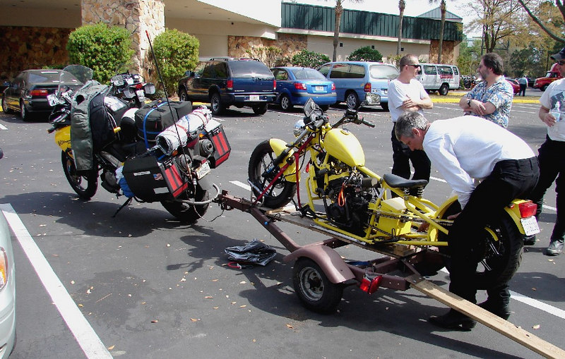 """Friday - 3/10:  Attending the annual meeting of the Iron Butt Association in Florida, this year in Jacksonville, one sees a variety of motorcycles.  This, however, was the only example of one motorcycle towing another to """"Trailer Week""""."""