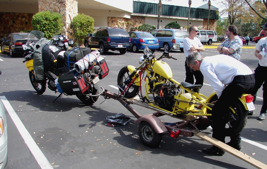 "Friday - 3/10:  Attending the annual meeting of the Iron Butt Association in Florida, this year in Jacksonville, one sees a variety of motorcycles.  This, however, was the only example of one motorcycle towing another to ""Trailer Week""."