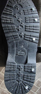 Sometimes the motorcycle's studded tires provide a surer grip than unenhanced footgear, so modifications must be made to that as well.