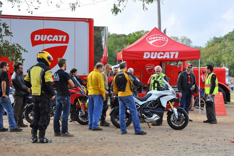 Ducati North America's Danny Carson tells the waiting crowd how the demo rides work