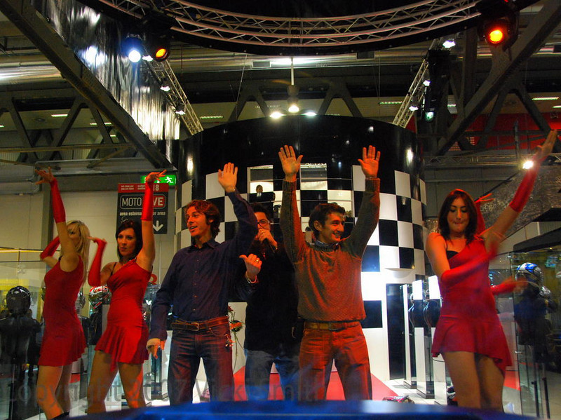 Music plays all day everywhere, the sound of the Milan motorcycle show is booming techno but this group was dancing to YMCA