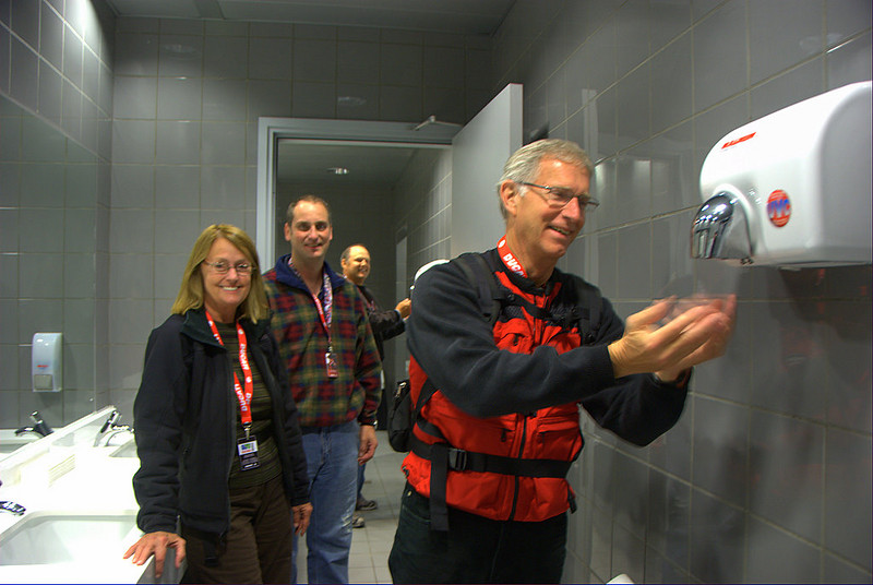 "That's Robin Lawrence, his wife Gail, Rich Lambrechts and Dwayne Freye, enjoying one of Italy's famous co-ed bathrooms. Dwayne and Robin are the winners of the Ducati Superbike Concorso and this trip to Milan is the ""Ducatisti Trip of a Lifetime"" they won from Ducati North America as owners of two of the best Ducati Superbikes in America.  The press conference was the first of many events they get to see over the next week. Now it's off to find some vino and grab a few hours sleep - tomorrow is a very big day!"