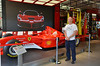 That's Gary in the official Ferrari store in Maranello.  When the doors open the speakers scream the sound of an F1 car passing.  It's really cool
