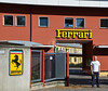 "Gary, posing for the standard ""I've been to Ferrari"" photo at the factory gates"