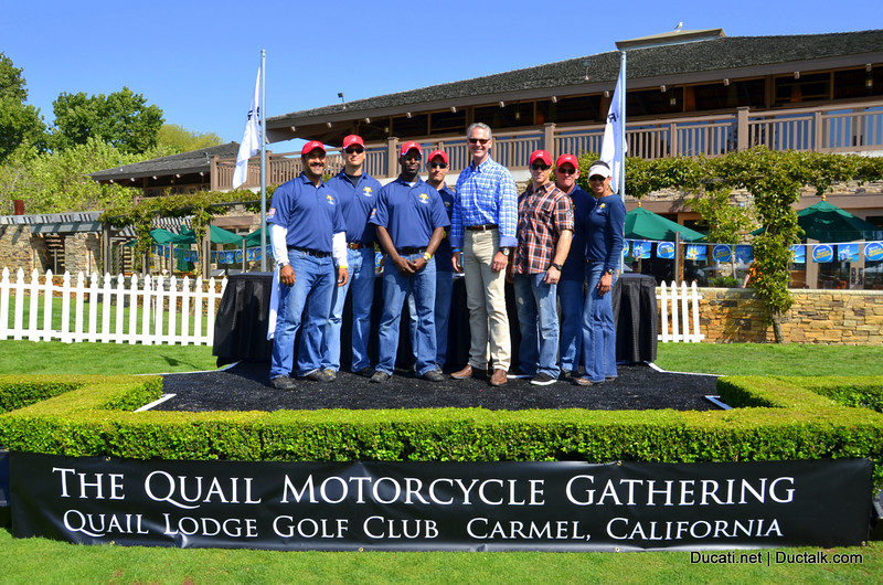 Gordon McCall of the Quail Lodge poses with one of the many groups the Quail Lodge events raise funds for, the Naval Post Graduate School Foundation
